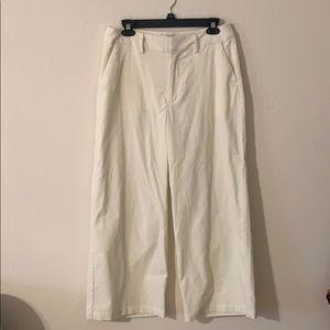 Wide leg trousers in cream.